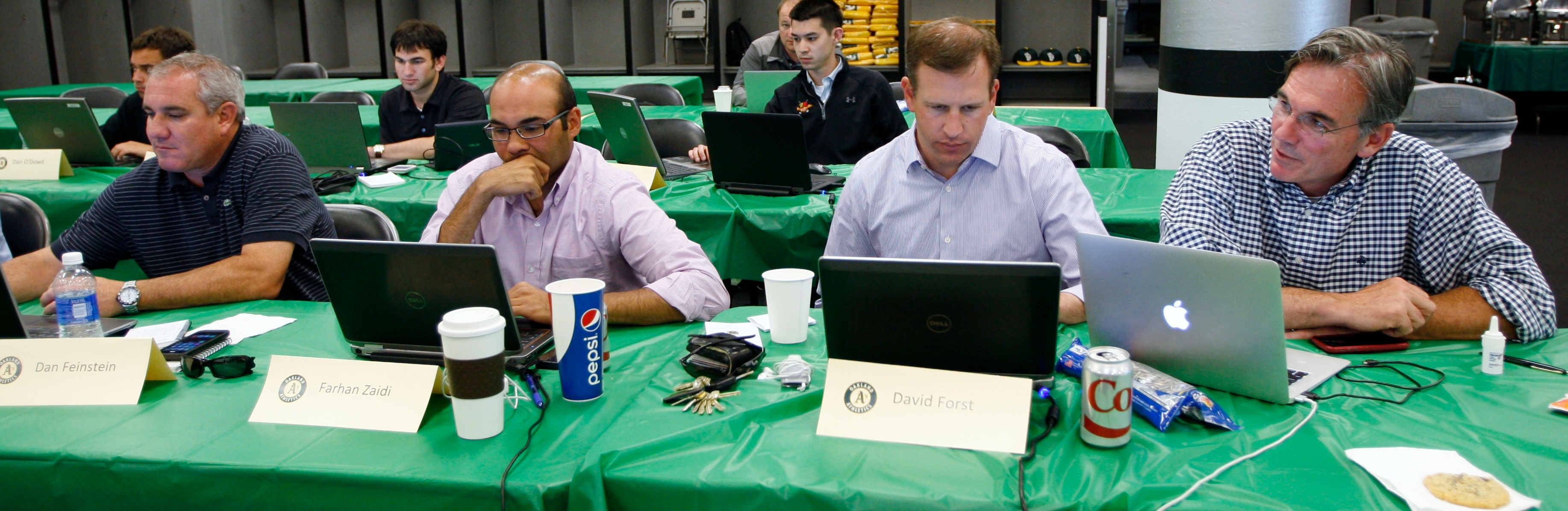 Scouting director Dan Feinstein, left, is part of the Oakland Athletics brain trust at the Major League Baseball draft along with GM Billy Beane, right, the architect of the Moneyball philosophy, June 2014. (Michael Zagaris)
