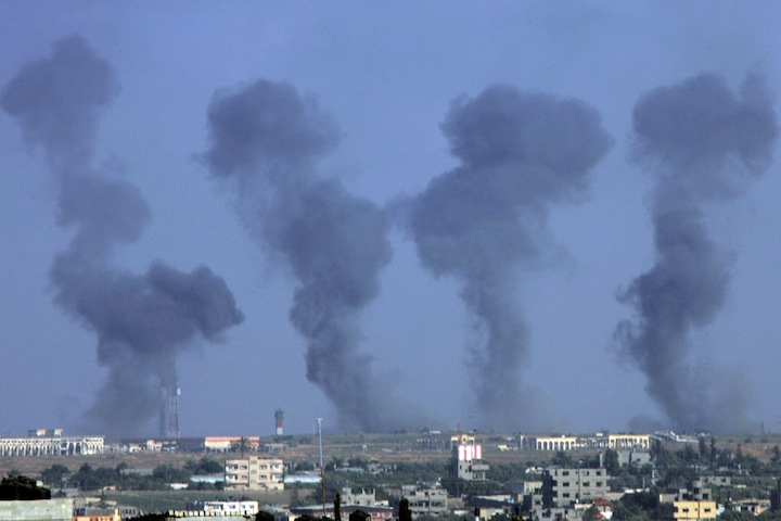 Black smoke rising following an Israeli air strike on the Gaza International Airport in Rafah, July 7, 2014. (Abed Rahim Khatib/Flash 90)