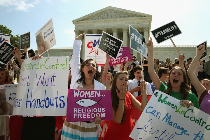 Demonstrators in Washington celebrate the U.S. Supreme Court decision in the Hobby Lobby case, June 30, 2014. (Mark Wilson/Getty Images)