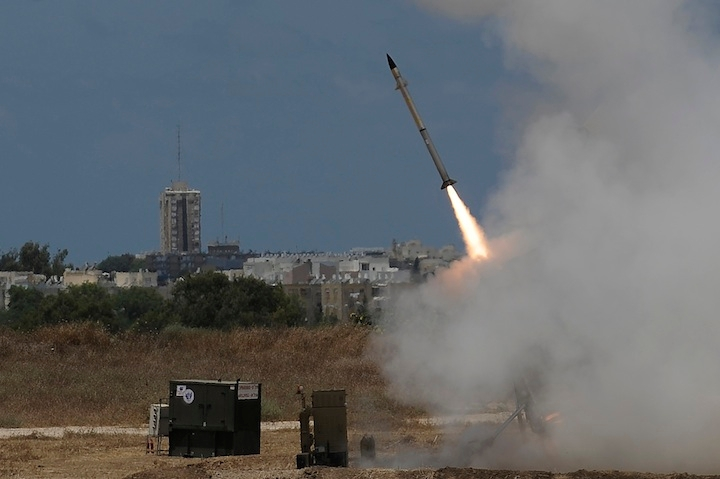 An Iron Dome missile defense battery set up near the southern Israeli town of Ashdod firing an interceptor missile, July 14, 2014.  (David Buimovitch/Flash 90)