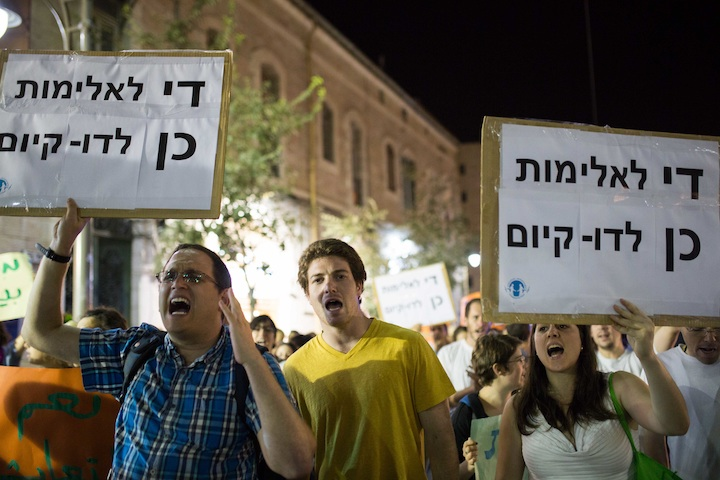 "Participants in an anti-racism rally in Jerusalem holding signs that say, ""Enough violence.Yes to co-existence,"" July 7, 2014. (Noam Revkin Fenton/Flash 90)"