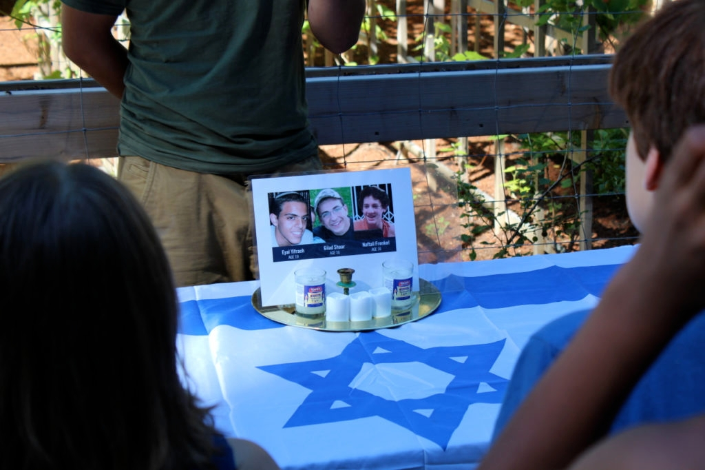 A memorial display pays tribute to the three murdered Israeli teens at Camp Solomon Schechter in Olympia, Washington. (Josh Niehaus)