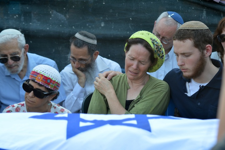 The mother of Naftali Fraenkel, Rachel Fraenkel, crying over the body of her son, during the joint funeral for three murdered Jewish teens in the Modiin cemetery, on July 1, 2014. (Flash 90)