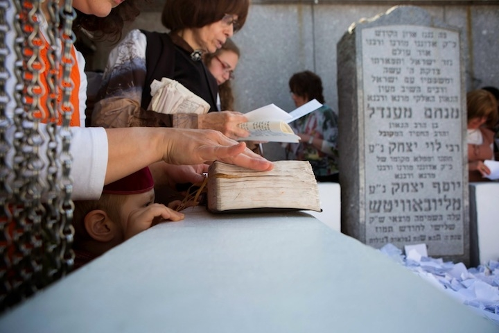 Women pray at the gravesite of the late Lubavitcher rebbe, Menachem Mendel Schneerson, on his 20th yahrzeit, in Queens, N.Y., July 1, 2014. (Adam Ben Cohen/Chabad.org)