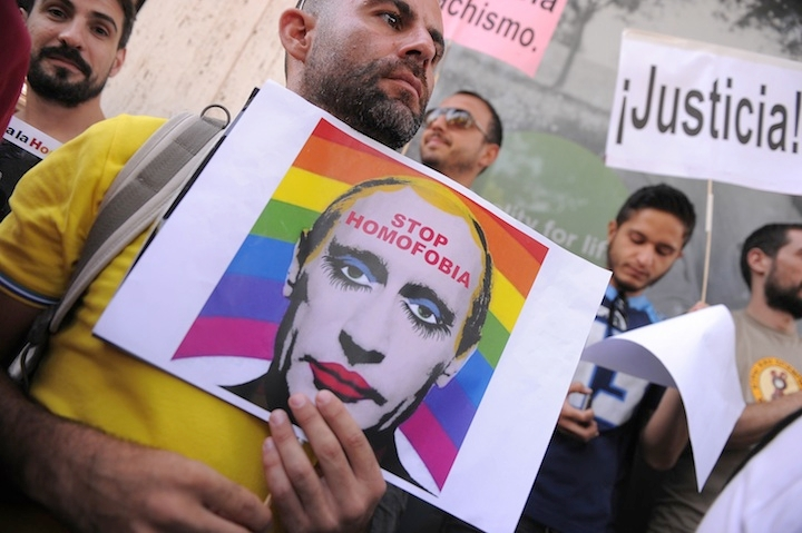 A man holds a sketch showing Russian President Vladimir Putin wearing lipstick during a protest against Russian anti-gay laws outside the Russian embassy on Aug. 23, 2013 in Madrid, Spain. (Denis Doyle/Getty Images)