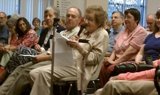 Former Pittsburgh Mayor Sophie Masloff, seated in the audience at ​a 2012 roundtable on Pennsylvania's voter ID law, reads from a prepared statement opposing the legislation. (Courtesy of The Jewish Chronicle)