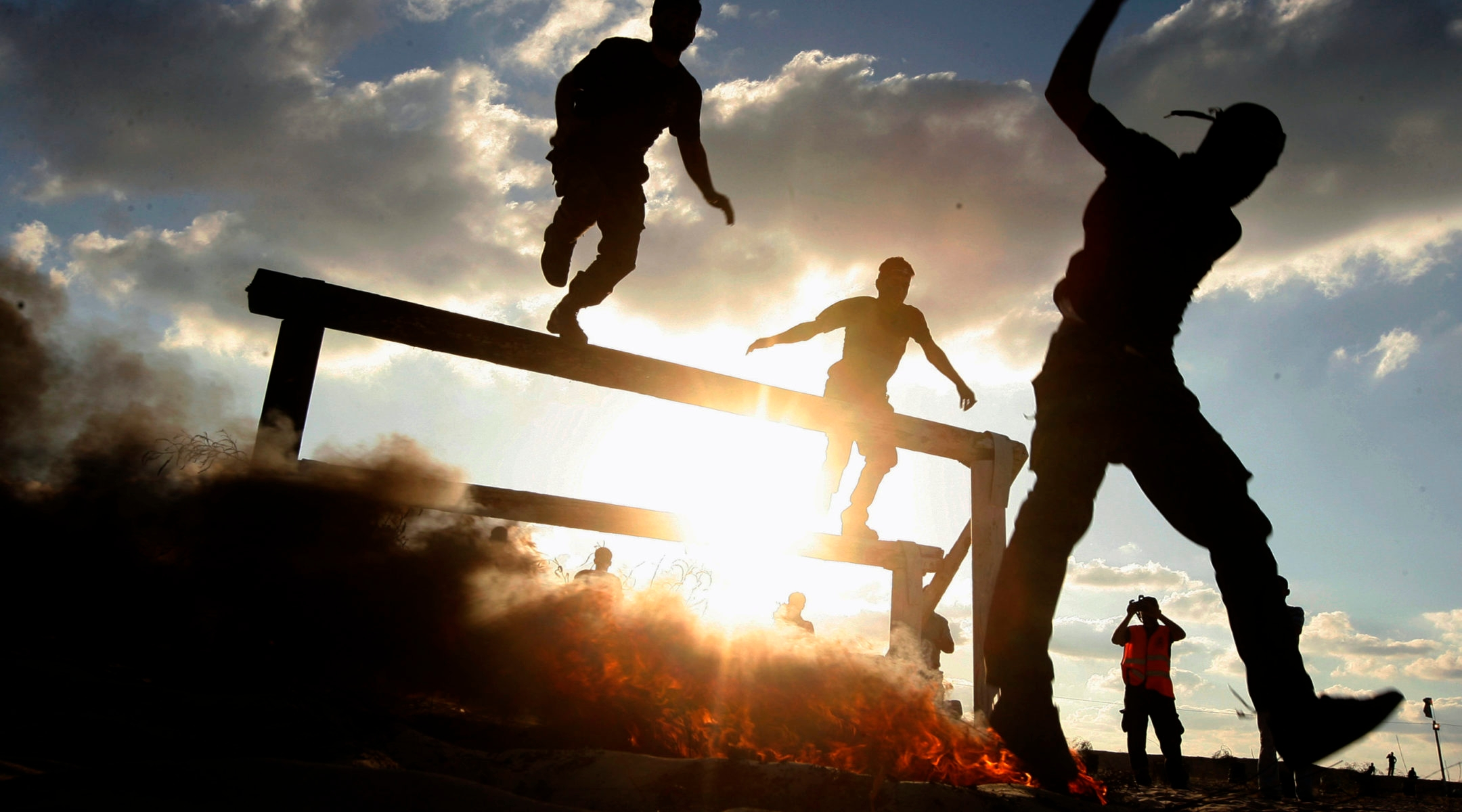 Palestinian militants of Al-Nasser Brigades, the armed wing of the Popular  Resistance Committees, show off their skills during their graduation  ceremony in ...