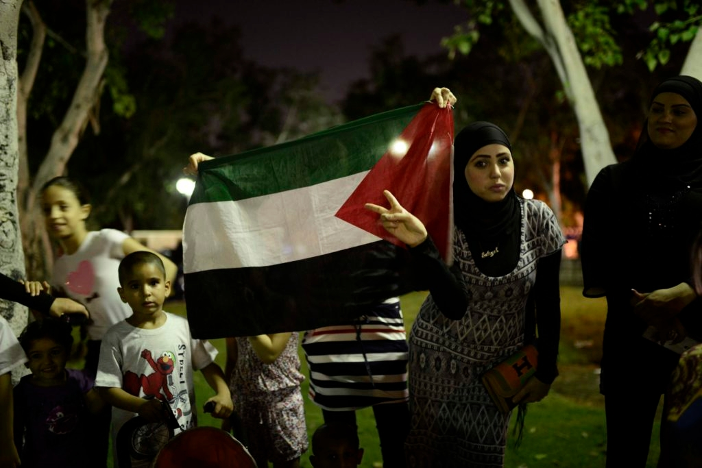 Israeli Arabs take part in a protest in the central Israeli city of Jaffa, near Tel Aviv, against Israel's offensive in the Gaza Strip, July 21, 2014.  (Tomer Neuberg/FLASH90)