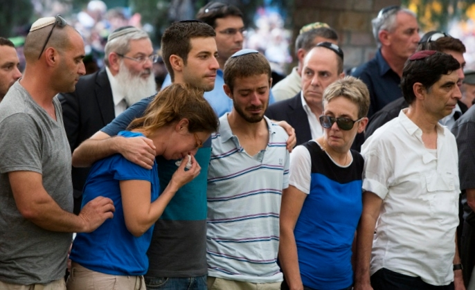 The family of Lt. Hadar Goldin mourning at his funeral at the military cemetery in Kfar Saba, Israel, Aug. 3, 2014.