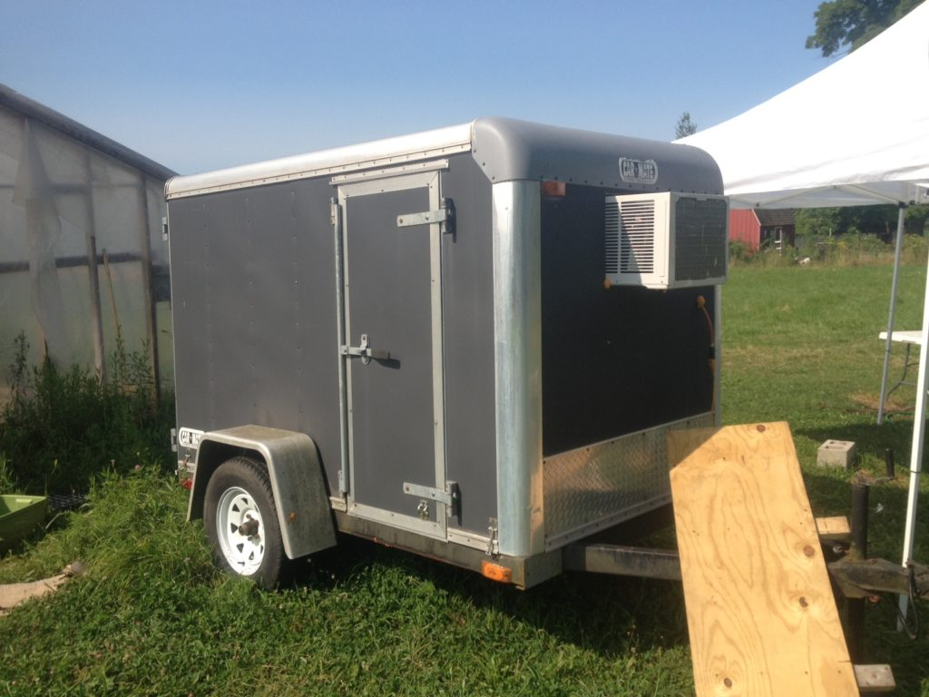 With the help of a CoolBot -- and a neighbor -- farmer Ben turned this used cargo trailer into a refrigerator. (Ben Harris)