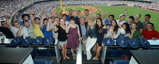 Randy and Mindy Levine, center, at Yankee Stadium in New York with the young men and women who are planning to make aliyah and serve in the Israeli army, (Shahar Azran, courtesy Nefesh B'Nefesh)
