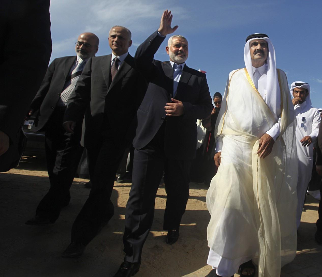 The emir of Qatar, Sheik Hamad bin Khalifa al-Thani, right, with Hamas Prime Minister Ismail Haniyeh, second from right, during an official visit to the Gaza Strip, Oct. 23, 2012. (Mohammed Salem-Pool/Getty Images)