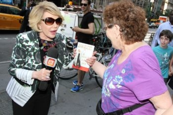Joan Rivers talks with people on the street while promoting her new book 'Diary of a Mad Diva' on June 30, 2014 in New York City. (Rob Kim/Getty Images)