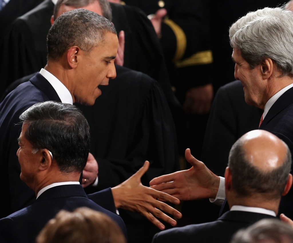 President Obama is greeted by U.S. Secretary of State John Kerry (R) during the State of the Union address to a joint session of Congress in the House Chamber at the U.S. Capitol on Jan. 28, 2014 in Washington, DC. (Mark Wilson/Getty Images)