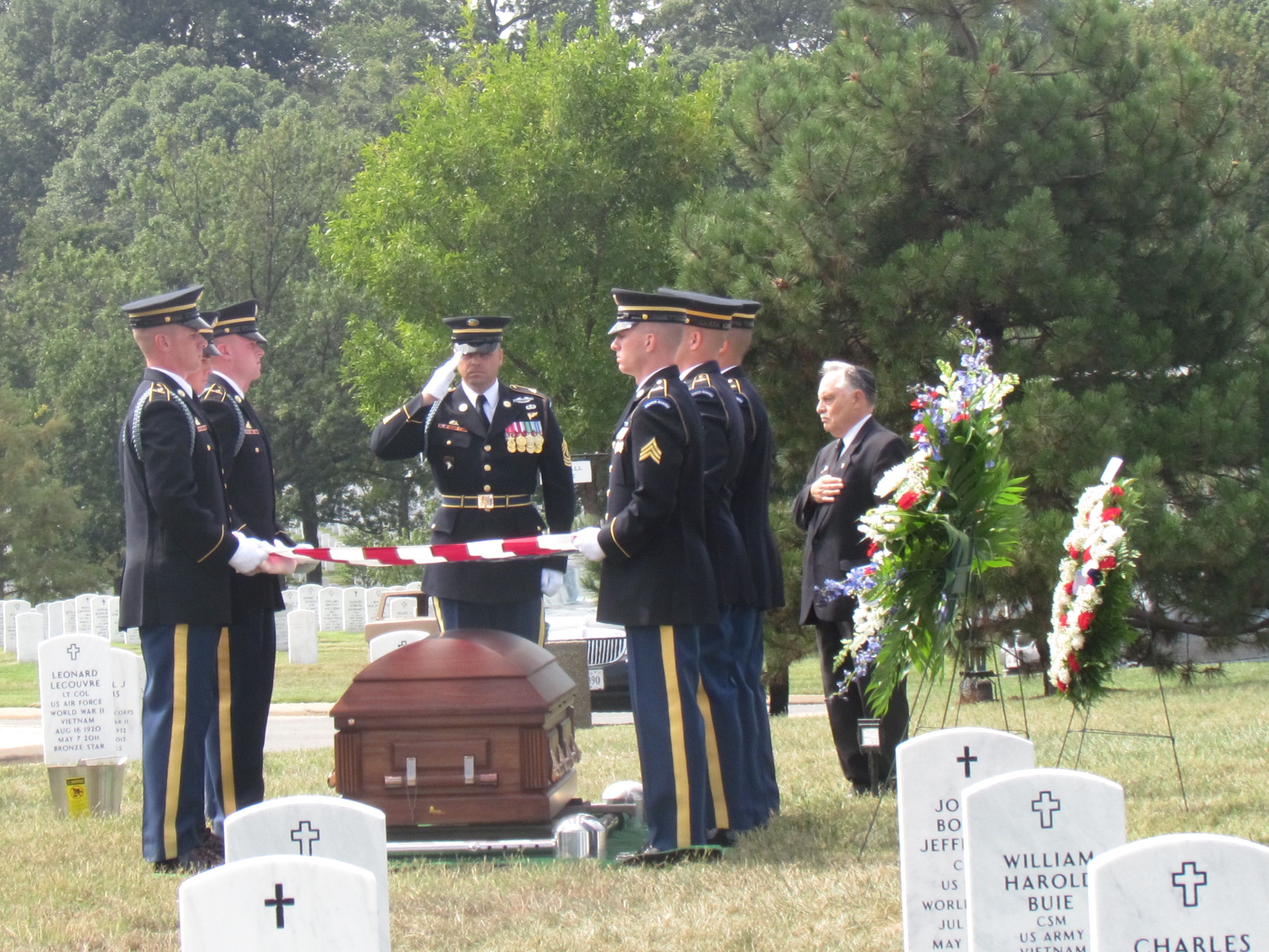 An Army Casket team lays to rest Pfc. Bernard Gavrin at Arlington National Cemetery on Sept. 12 2014 while Rabbi Marvin Bash looks on. (Ron Kampeas)