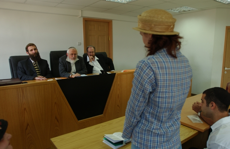 A women converts to Judaism in front of a three-judge Orthodox rabbinic court in Jerusalem. (Flash90)