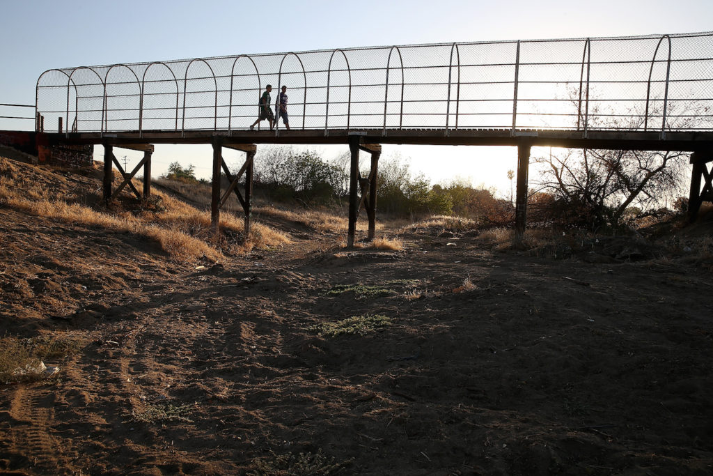 A footbridge spans a completely dry river bed, Sept. 4, 2014 in Porterville, Calif. (Justin Sullivan/Getty Images)