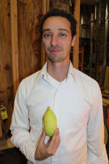 Etrog vendor Tsvi Danon with one of his high-end products. (Hillel Kuttler)