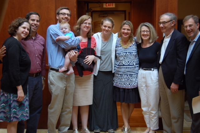 Caroline Potter, in blue shirt with triangles, celebrates with family, friends and clergy from Temple Sinai, a Reform synagogue in Brookline, Mass., after her conversion ceremony, Aug. 1, 2014. (Mayyim Hayyim)