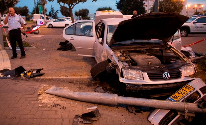 The car that crashed into a Jerusalem train station, killing an infant and injuring eight, in what is being probed as a terrorist attack.  (Yonatan Sindel/Flash90)