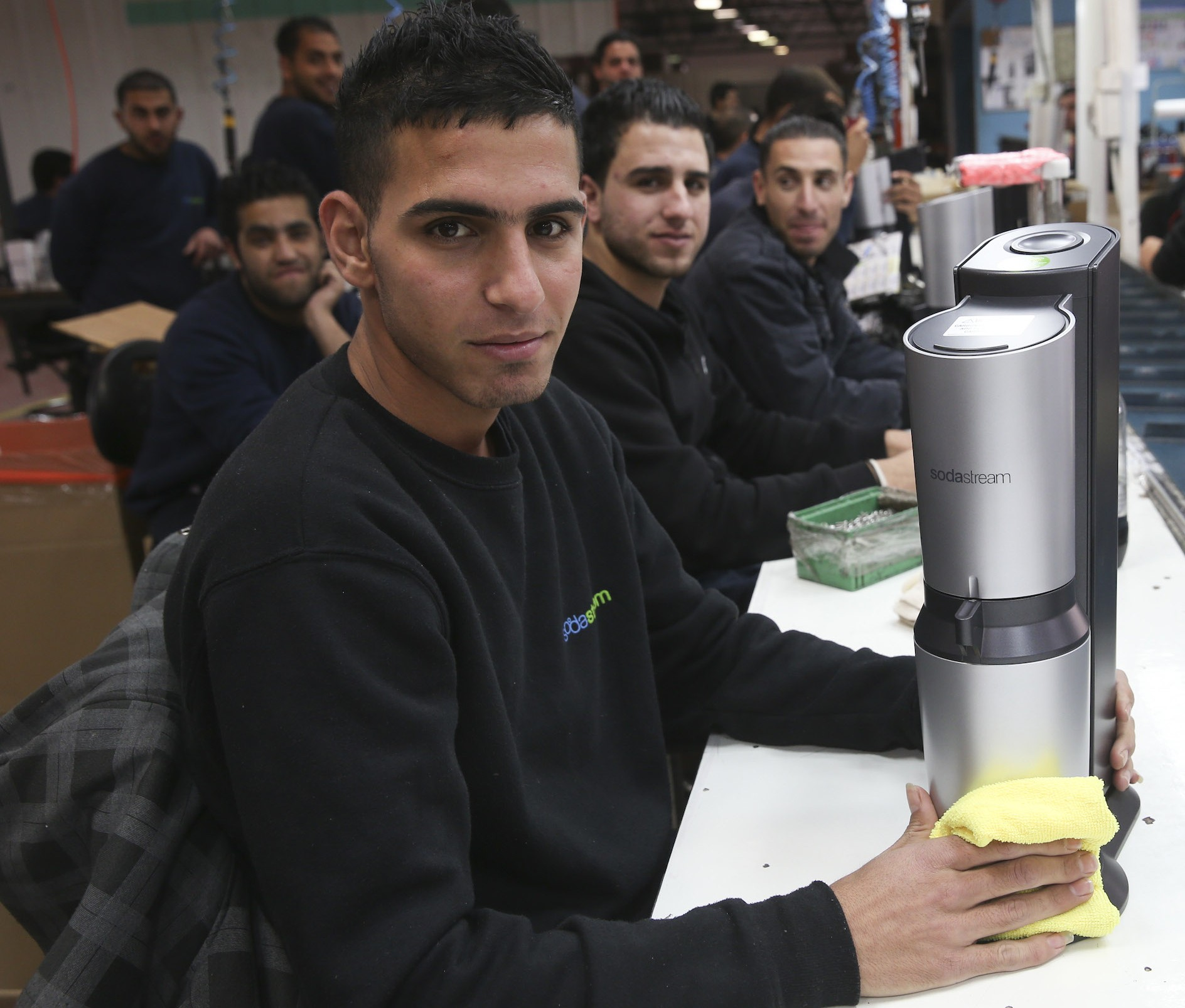 Some of the hundreds of Palestinians who work at SodaStream's West Bank factory that is shutting down. (Nati Shohat/Flash90)