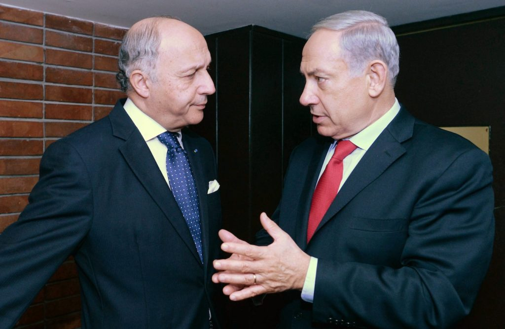 French Foreign Minister Laurent Fabius, pictured during the visit to Israel of President Francois Hollande in November 2013, recently pledged to recognize Palestinian statehood within two years if peace negotiations collapse. (Kobi Gideon/GPO/FLASH90)