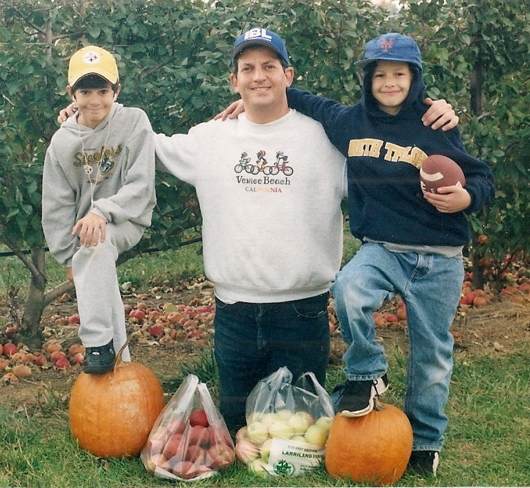 Hillel Kuttler is flanked by sons Yossi, left, and Gil in one of their apple-picking adventures years ago at a Maryland orchard. (Courtesy of Hillel Kuttler)