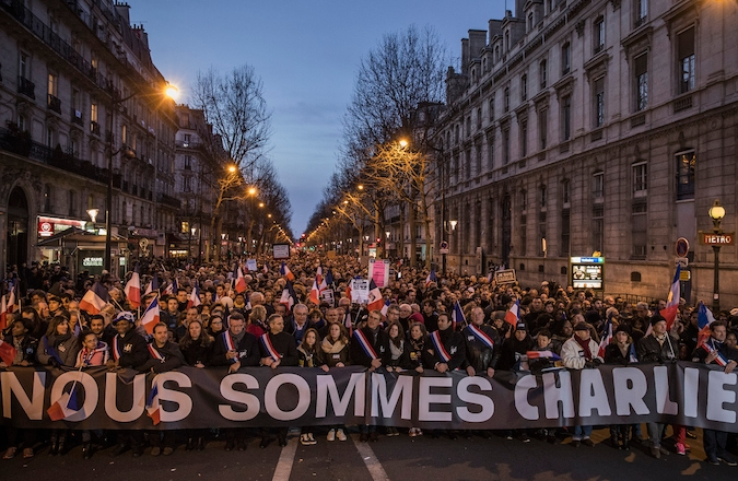 On Jan. 11, 2015 demonstrators make their way along Place de la Republique during a mass unity rally following the recent terrorist attacks in Paris, France. (Photo by Dan Kitwood/Getty Images)
