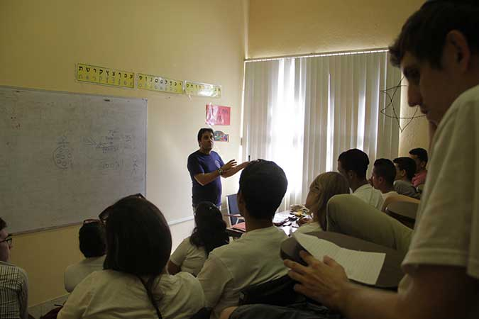 Isac Quiñones, 47, teaches 16- to 25-year-olds at Havana's Albert Einstein Hebrew School at Beth Shalom synagogue. The school, which operates on Sunday, has 168 students. (Josh Tapper)