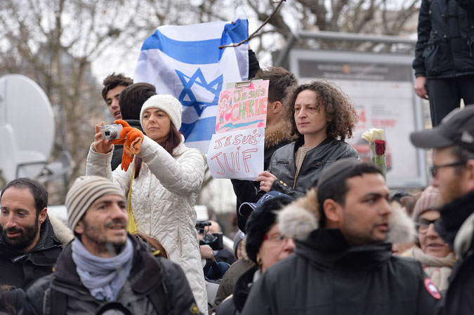 People gather outside the Paris kosher supermarket Hyper Cacher as Benjamin Netanyahu, Prime Minister of Israel, pays his respect to the victims following the recent terrorist attacks on January 12, 2015. (Aurelien Meunier/Getty Images)