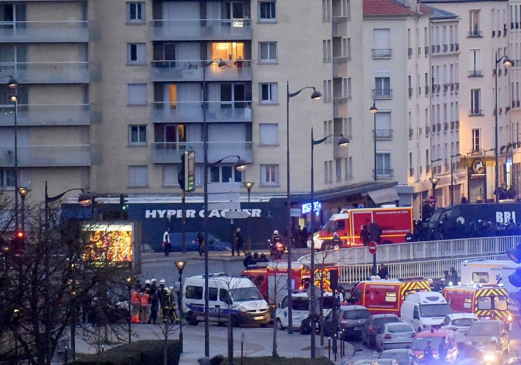 French firemen and emergency responders enter a kosher supermarket during the hostage situation at Port de Vincennes in Paris, Jan. 9, 2015. (Antoine Antoniol/Getty Images)