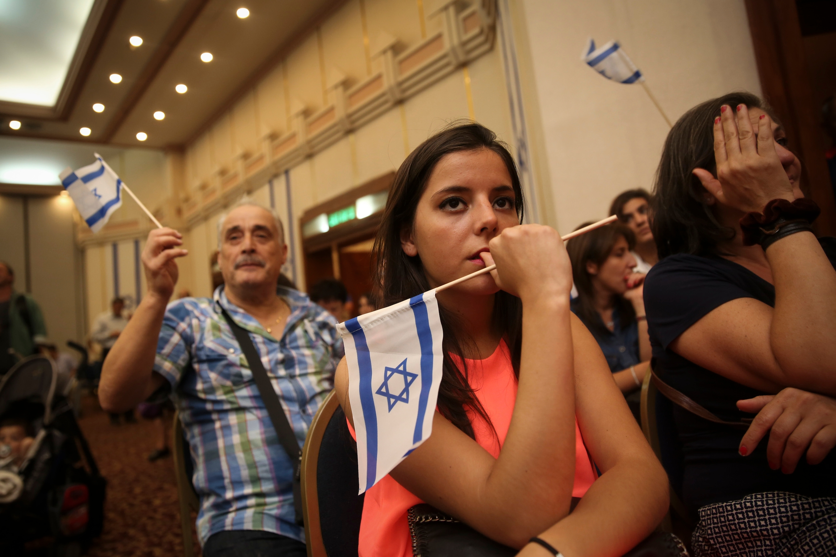 New French immigrants to Israel seen during a welcome ceremony at the Ramada Hotel in Jerusalem, July 17, 2014. (Hadas Parush/Flash90)