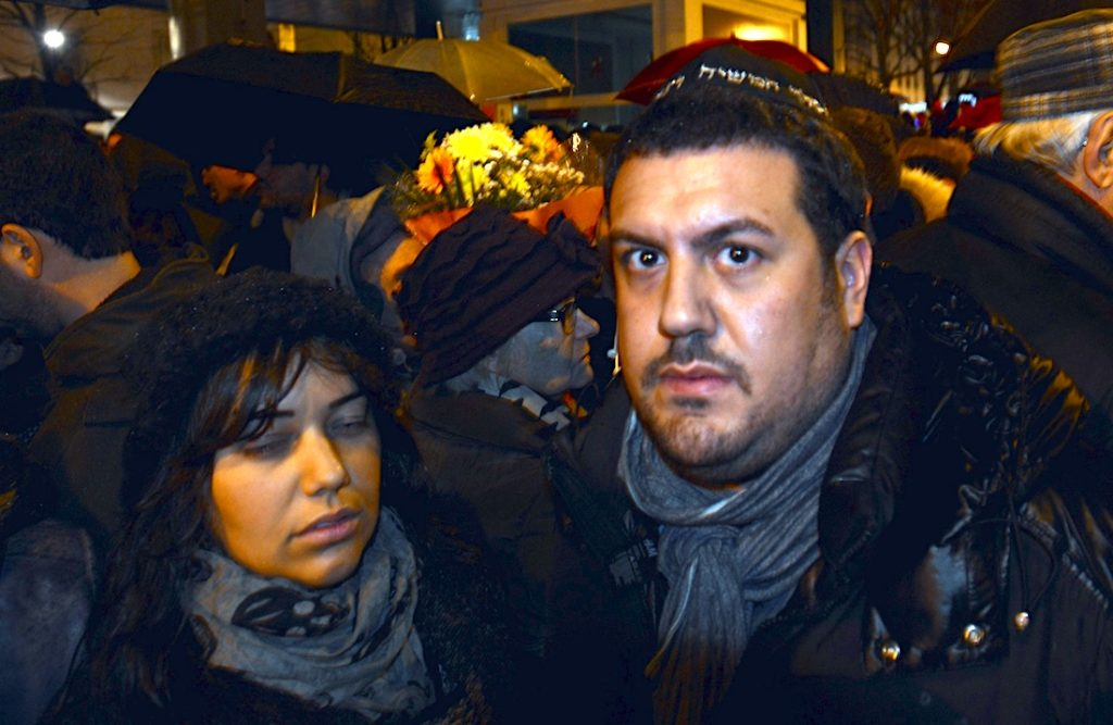 Joyce Halimi, left, and her husband Julien attending a vigil for victims of an attack on a kosher supermarket in Paris, Jan. 10, 2015. (Cnaan Liphshiz)