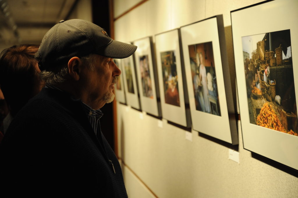 A visitor examines a photo by Nobel Laureate Martin Kaplus at the opening of an exhibition of his photographs in Washington, Jan. 14, 2015. (Peter Cutts/Austrian Cultural Forum)