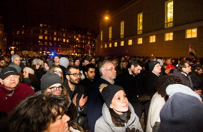 Thousands attend a solidarity march at Copenhagen's Great Synagogue following the slaying of a Jewish volunteer guard outside the building early Sunday morning.