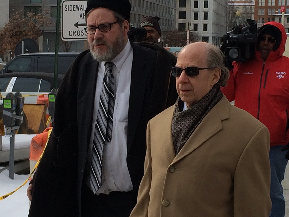 Rabbi Barry Freundel, left, with his lawyer, Jeffrey Harris, outside the courthouse where he pleaded guilty to 52 misdemeanor counts of voyeurism for spying on women at his Orthodox synagogue's mikvah, Feb. 19, 2015. (Dmitriy Shapiro / Washington Jewish Week)