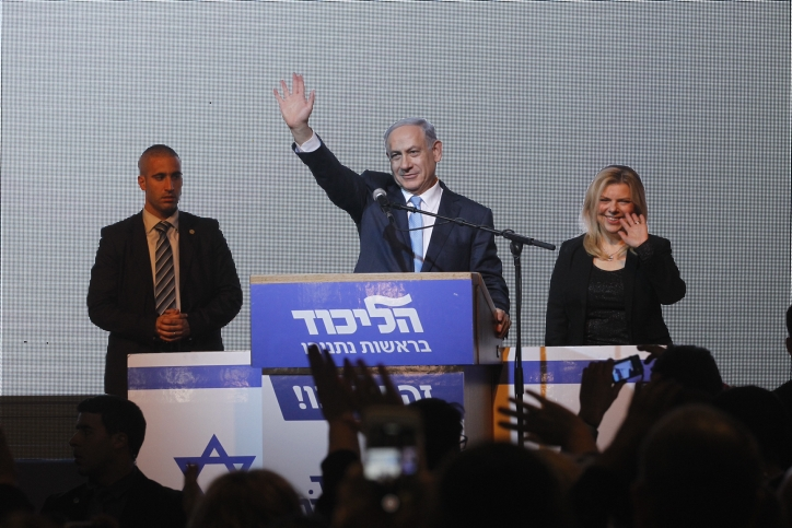 Benjamin Netanyahu celebrates on Election Day as unofficial results show his Likud Party with 27 or 28 seats in Israel's Knesset, March 17, 2015. (Miriam Alster/Flash90)