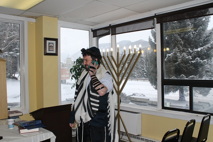 Dovid Mintz, the Chabad rabbi in Vail, Colo., works the phone trying to corral a minyan on a powdery morning at one of North America's most popular ski towns. (Uriel Heilman)