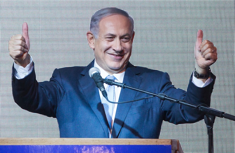 Israeli Prime Minister Benjamin Netanyahu celebrating after the close of polls on Election Day, March 18, 2015. (Miriam Alster/FLASH90)
