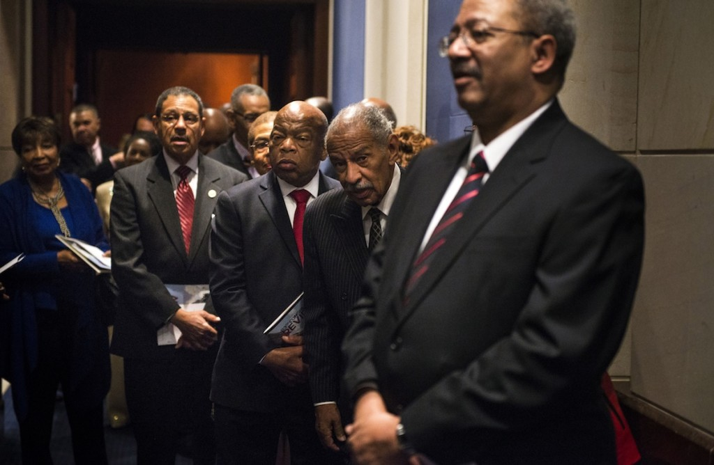 Rep. John Lewis (D-Ga.), second from right, with other members of the Congressional Black Caucus before a ceremony at the U.S. Capitol, Jan. 6, 2015. (Gabriella Demczuk/Getty Images)