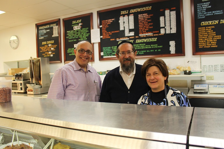 Joshua Horowitz, left, bought the East Side Kosher Deli in February 2015 from Michael and Marcy Schreiber, who had owned it for 17 years. (Uriel Heilman)