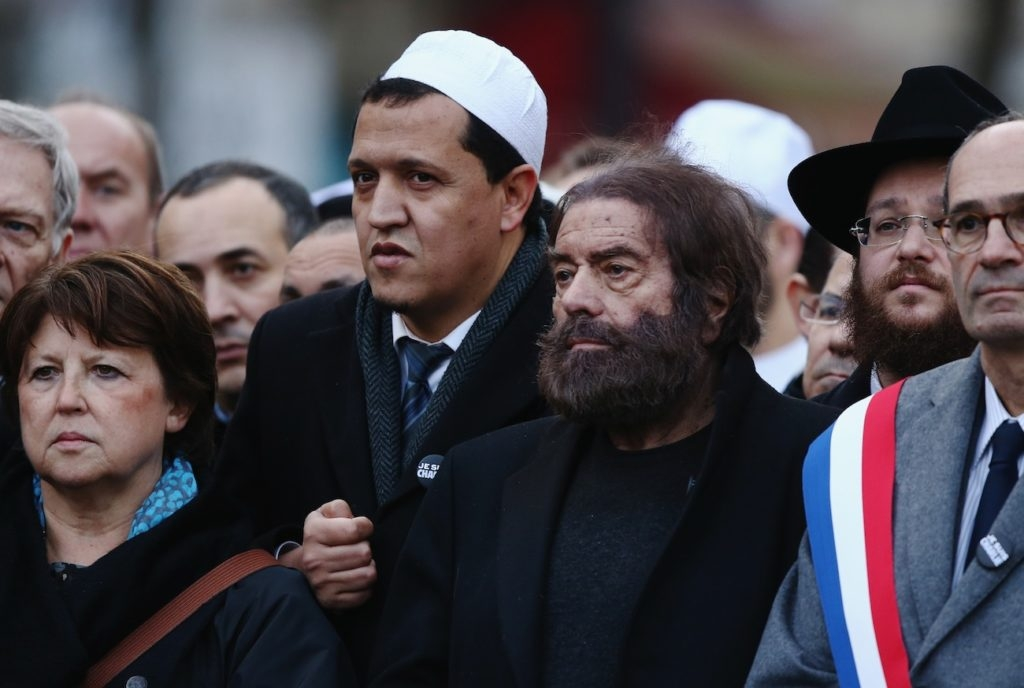 Marek Halter, second from right, and Hassen Chalghoumi, in white cap, at a mass rally in Paris following the shootings at the Charlie Hebdo magazine and the Hyper Cacher supermarket, Jan. 11, 2015. (Dan Kitwood/Getty Images)