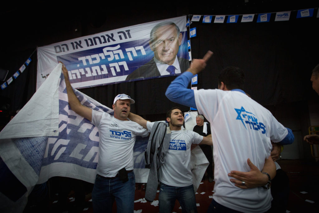Supporters of the Likud party celebrate at party headquarters in Tel Aviv, March 18, 2015. (Miriam Alster/FLASH90)