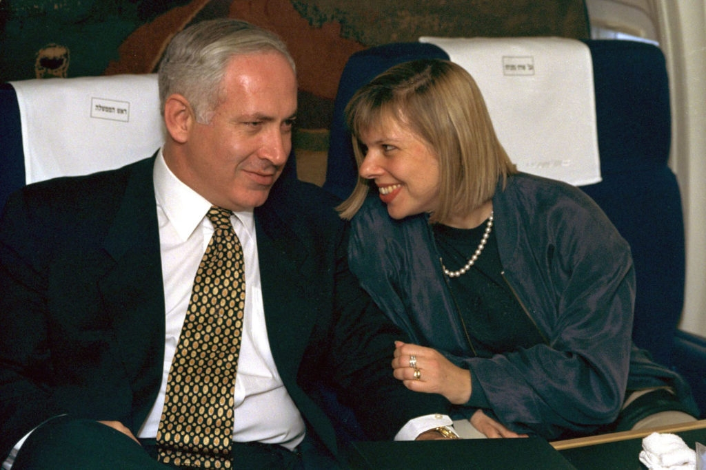 Prime Minister Benjamin Netanyahu with his wife Sara Netanyahu on board an Israeli Air Force jet, en route to a state visit to the United States July 9, 1996, soon after being elected prime minister. (Yaakov Saar/GPO via Getty Images)