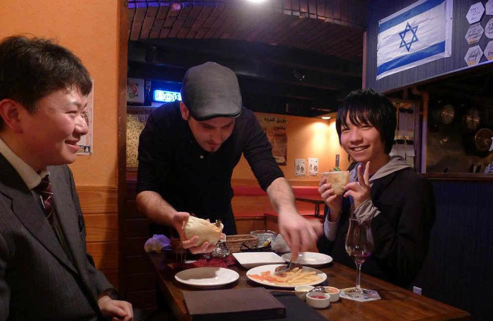 Roy Somech serving patrons at a restaurant he owns in Sendai, Japan, in 2012. (Courtesy of Roy Somech)