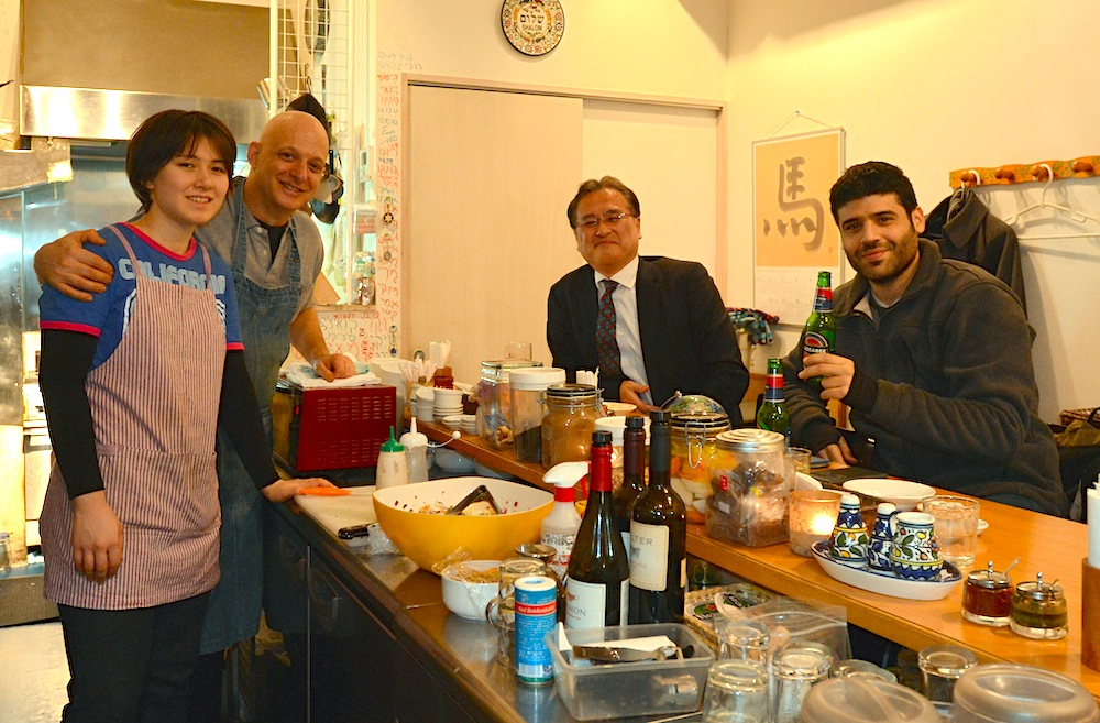 Dan Zuckerman, second from left, at his restaurant Ta-im in Tokyo, Dec. 24, 2015. (Cnaan Liphshiz)