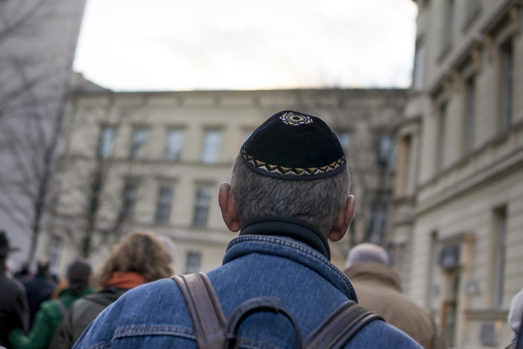 A man wears a kippah as he takes part in a silent march to commemorate the 75th anniversary of the Kristallnacht pogroms, Nov. 9, 2013 in Berlin. (Carsten Koall/Getty Images)