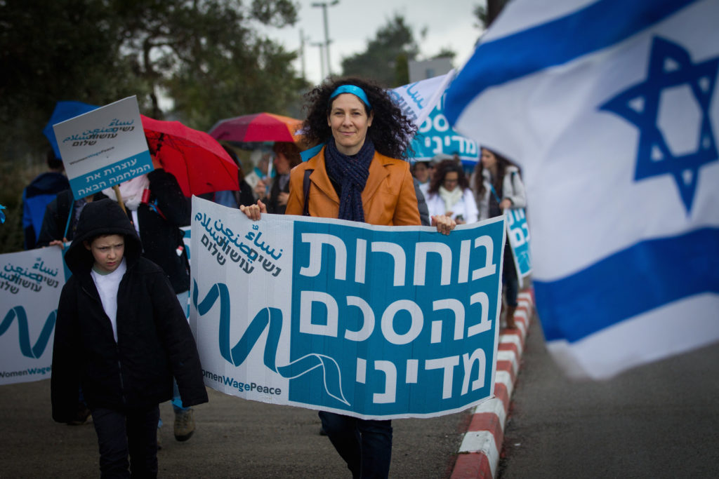 Women from the ' Women Wage Peace ' movement demonstrate outside the Knesset March 4, 2015. (Miriam Alster/Flash90)