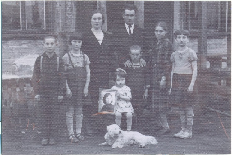 This undated photograph of the Achun family shows Yocheved holding a photograph of her Aunt Ruth, who was tormented by the presumed Holocaust deaths of these relatives. (Courtesy of Audrey Greenberg)