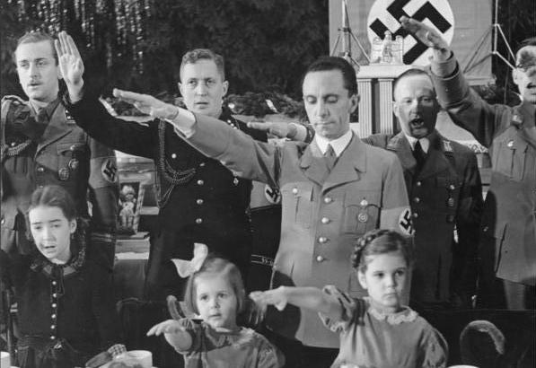 Joseph Goebbels with his daughters, Hilde (center) and Helga (right), at a Christmas celebration in Berlin, 1937. (German Federal Archives)